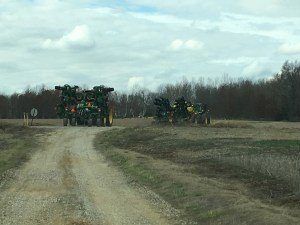 The tractors and implements start the 6-mile trip back to the main farm. John and Brandon are driving.
