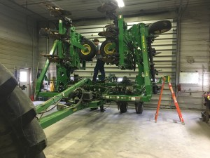 John works on replacing some of the row unit 'scrapers'... I'd call them 'boots'.  These operate on the back side of the opener disks, and make the opposite side of the trench for in injection of the NH3.    These seem to be a high-wear item.