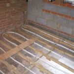 Side and rear extension with piled beams in Crawley