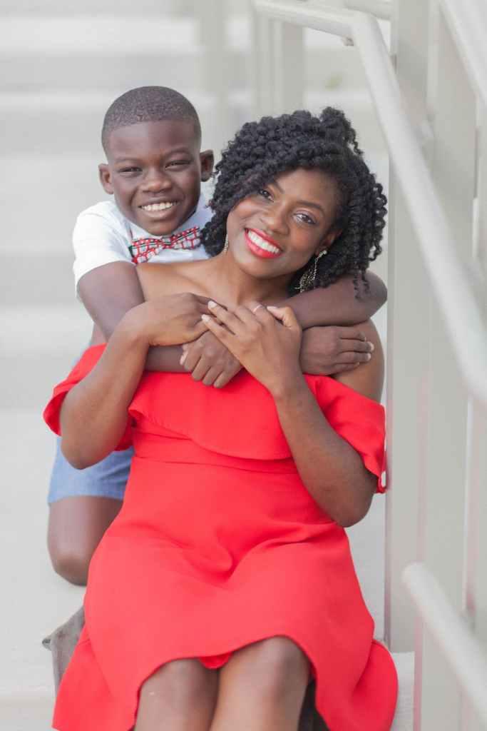 photo of boy hugging his mom