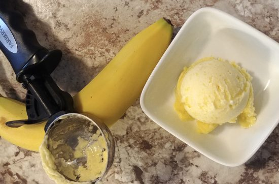 Scooped Pineapple Gelato In White Dish with banana and scoop
