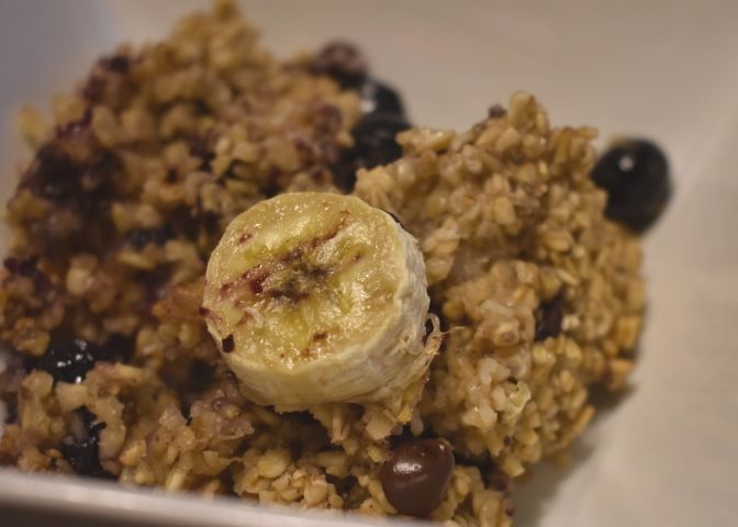Bowl of blueberry banana chocolate chip baked oatmeal