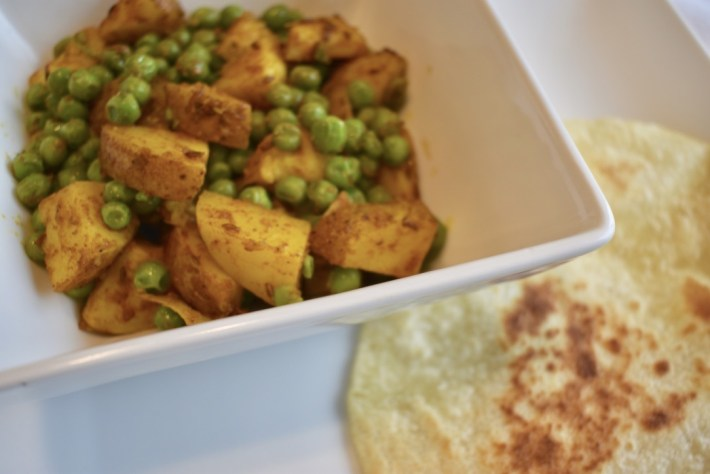 Aloo Mutter Jeera with a roti (Indian curried potatoes and peas)