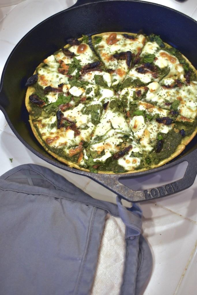 chickpea crust pesto feta pizza with sun dried tomatoes