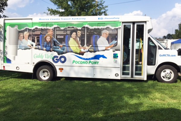 "Passenger side of ""Pocono Pony"" shared ride bus."