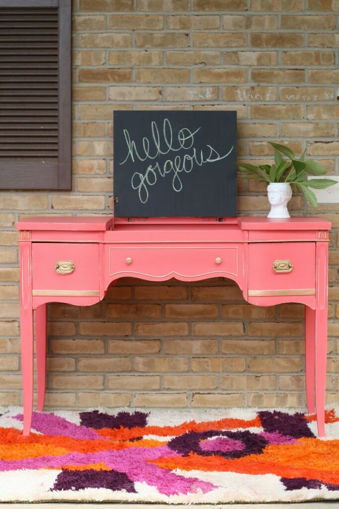 gilded coral crush vanity with chalkboard