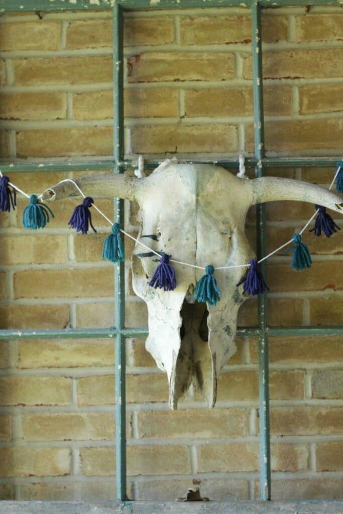 Bull Skull with tassel garland on Fall porch