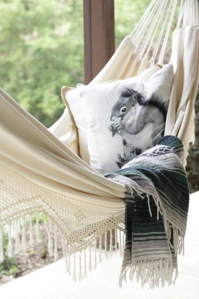 Fall hammock with squirrel pillow and Mexican blanket