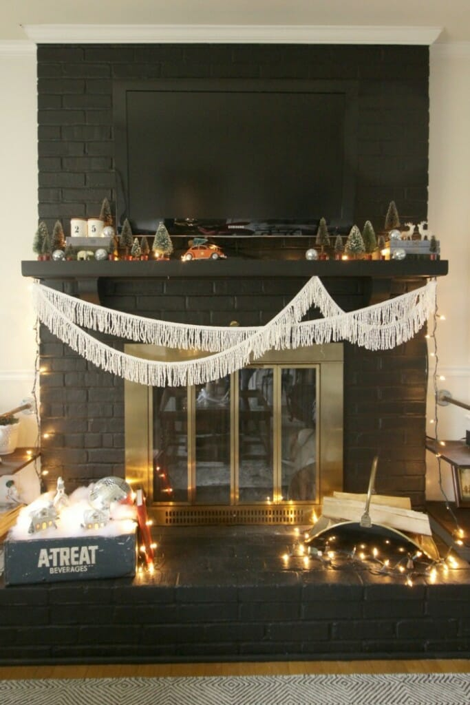 Eclectic Black Christmas Mantle with Fringe and Vintage Bottle Brush Trees