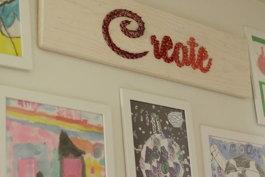 String art in kids art gallery wall