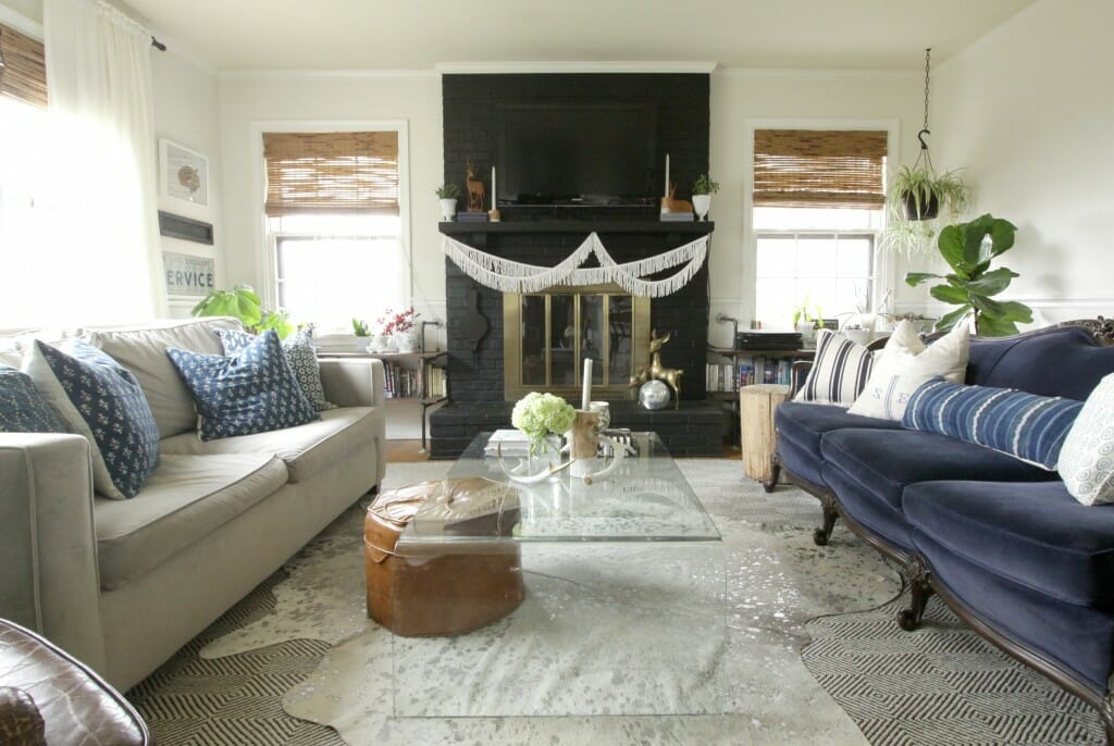 Eclectic Living room in blue, white, black, with glass coffee table and vintage sofa