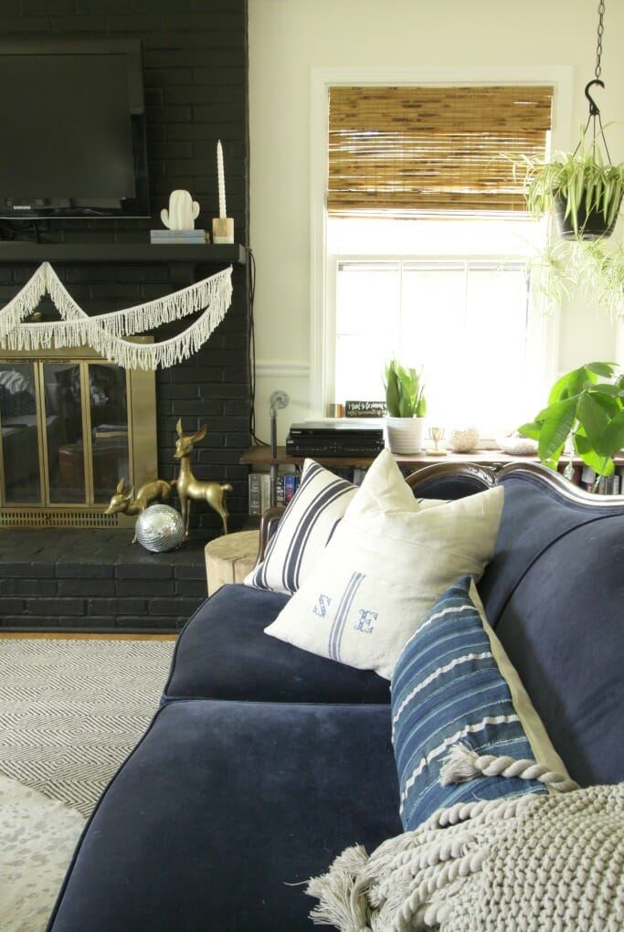 Fabulous Vintage Velvet Sofa and Black Fireplace- modern boho-eclectic
