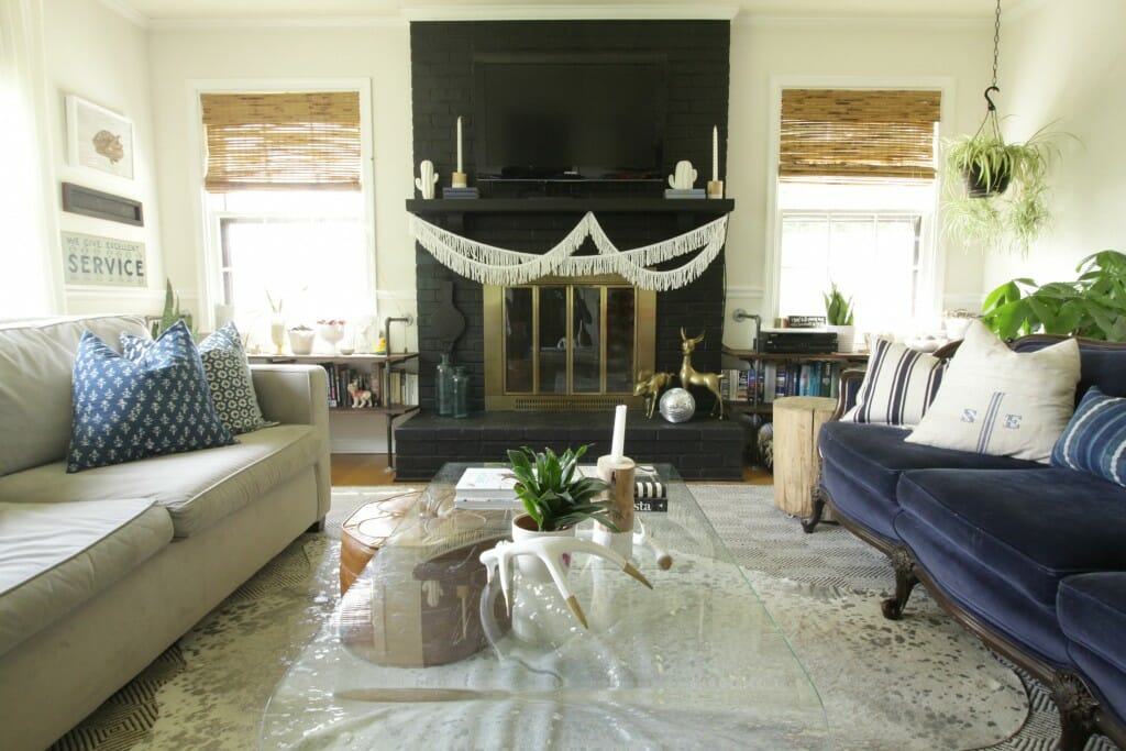Eclectic Modern Boho Living Room- Vintage Navy Velvet Sofa, Black fireplace