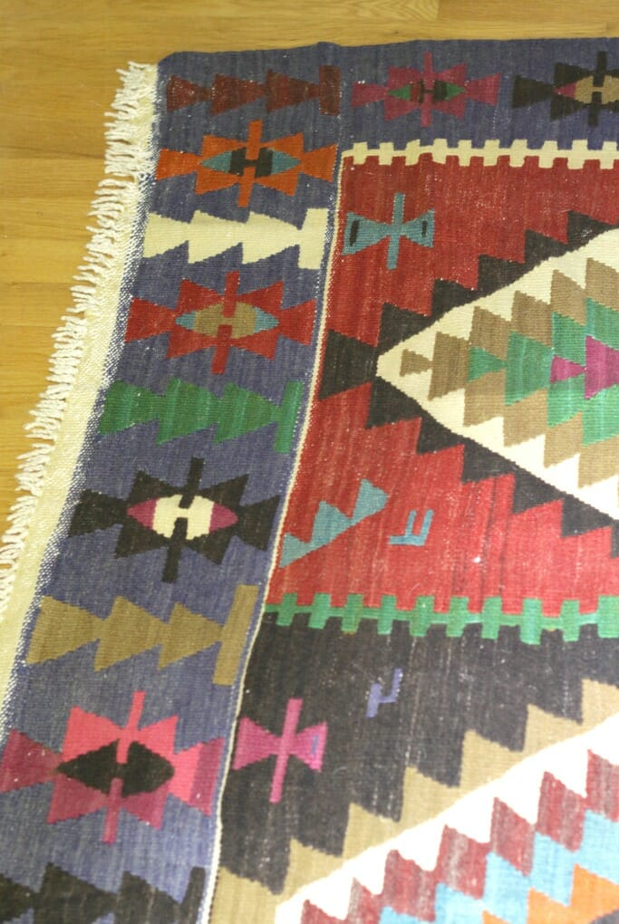 Fringe on ends of Vintage Kilim Rug