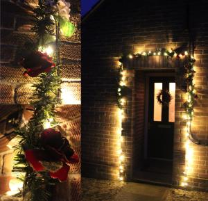 christmas lights around porch with rose garland