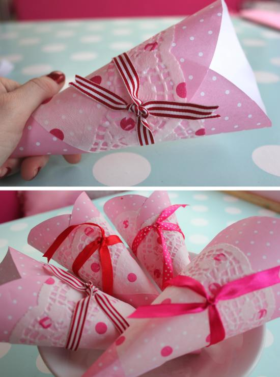 DIY pink paper birthday party cones with doilies for popcorn or sweets