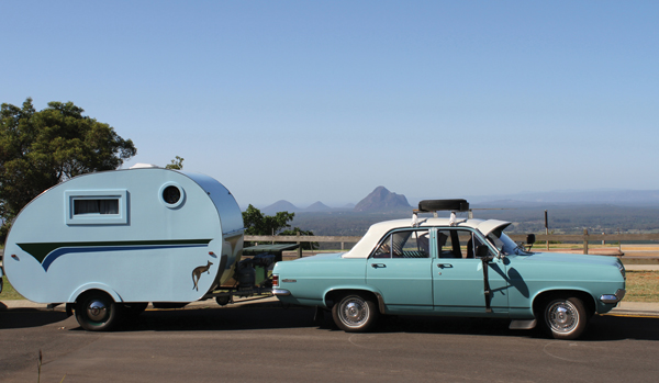 blue retro car and trailer from vintage caravan style book