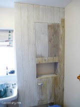 using recycled wood from a skip to make a beach hut bathroom floor and storage-10