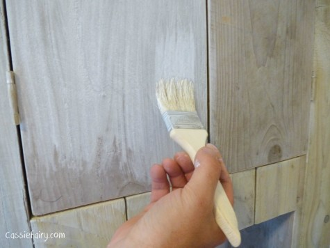 using recycled wood from a skip to make a beach hut bathroom floor and storage-11