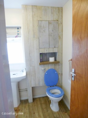 using recycled wood from a skip to make a beach hut bathroom floor and storage-12