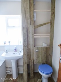 using recycled wood from a skip to make a beach hut bathroom floor and storage-3