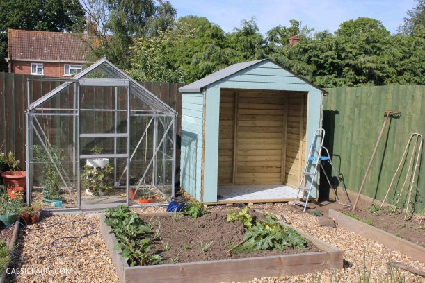 diy painting and installing small shed - duck egg blue beach hut in garden-11