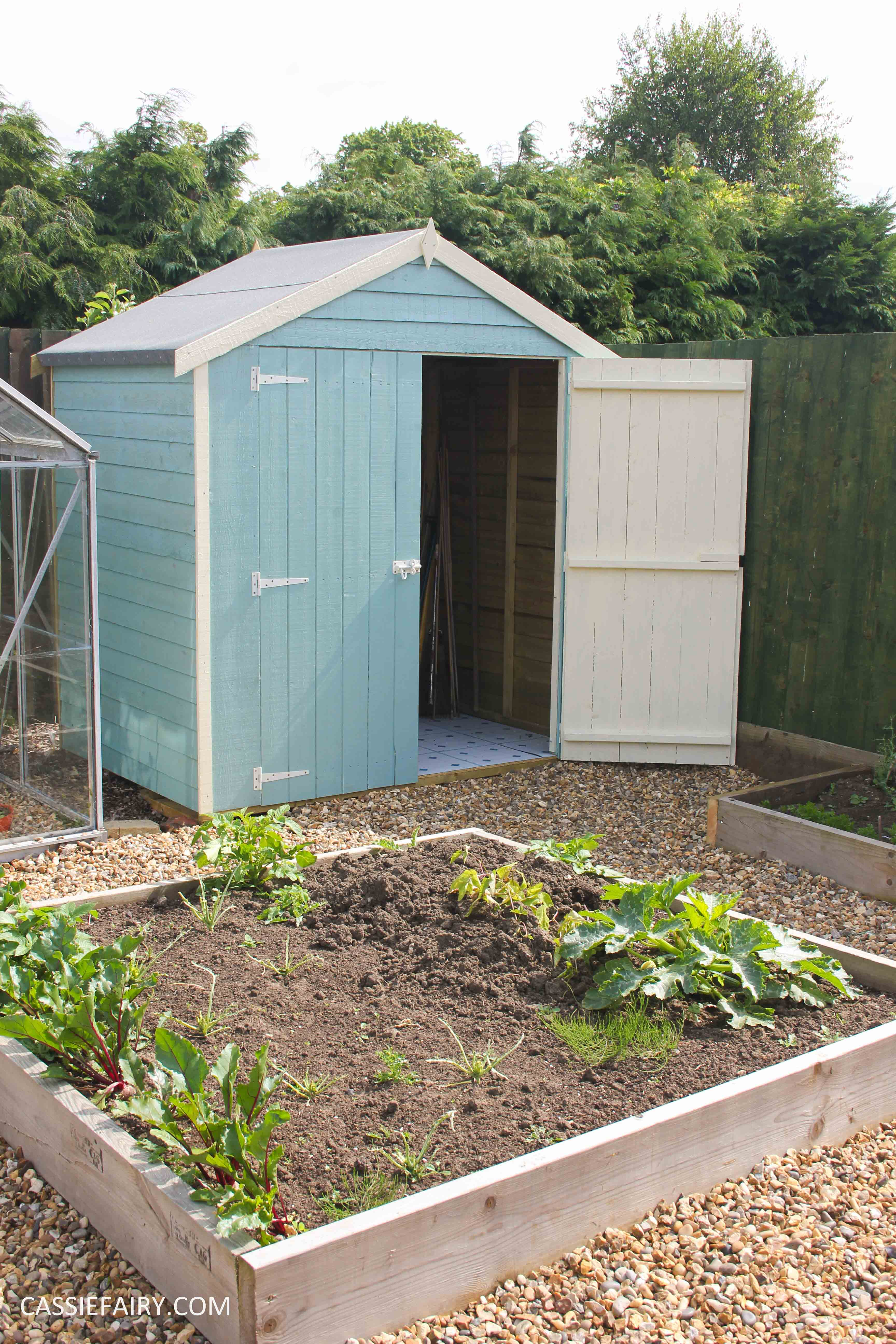 diy painting and installing small shed - duck egg blue beach hut in garden-23