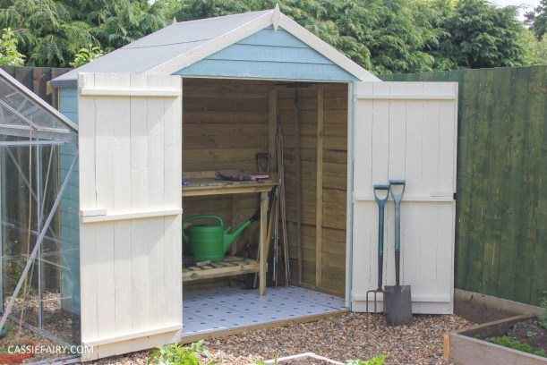diy painting and installing small shed - duck egg blue beach hut in garden-24