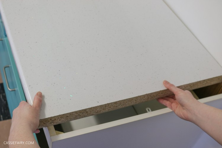 photo of a new white worktop being installed in a kitchen