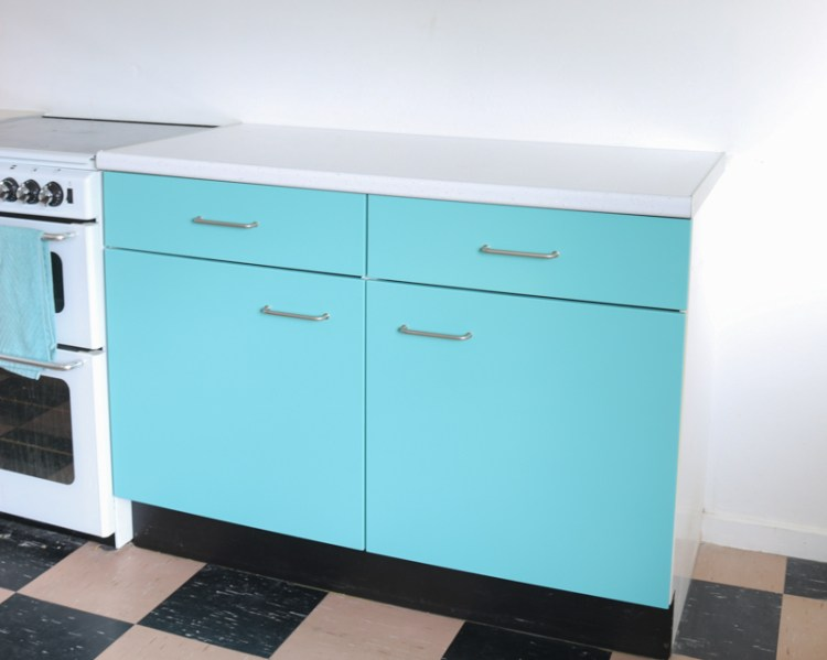 photo of mdf cabinets painted in turquoise spray paint