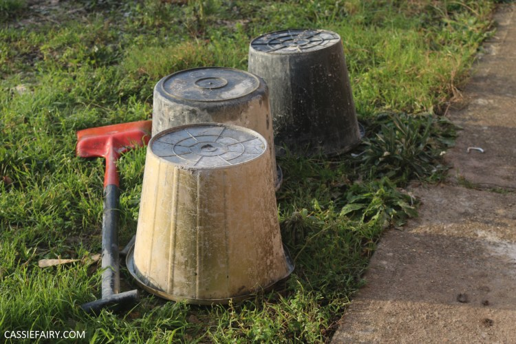 three upturned buckets in garden