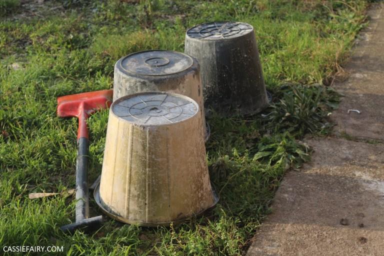 three upturned buckets in garden