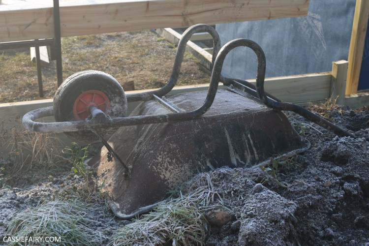 Photo of upside down wheelbarrow, covered in frost