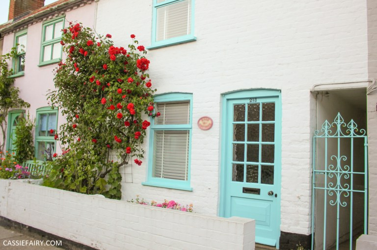 small terraced cottage with blue door and windows