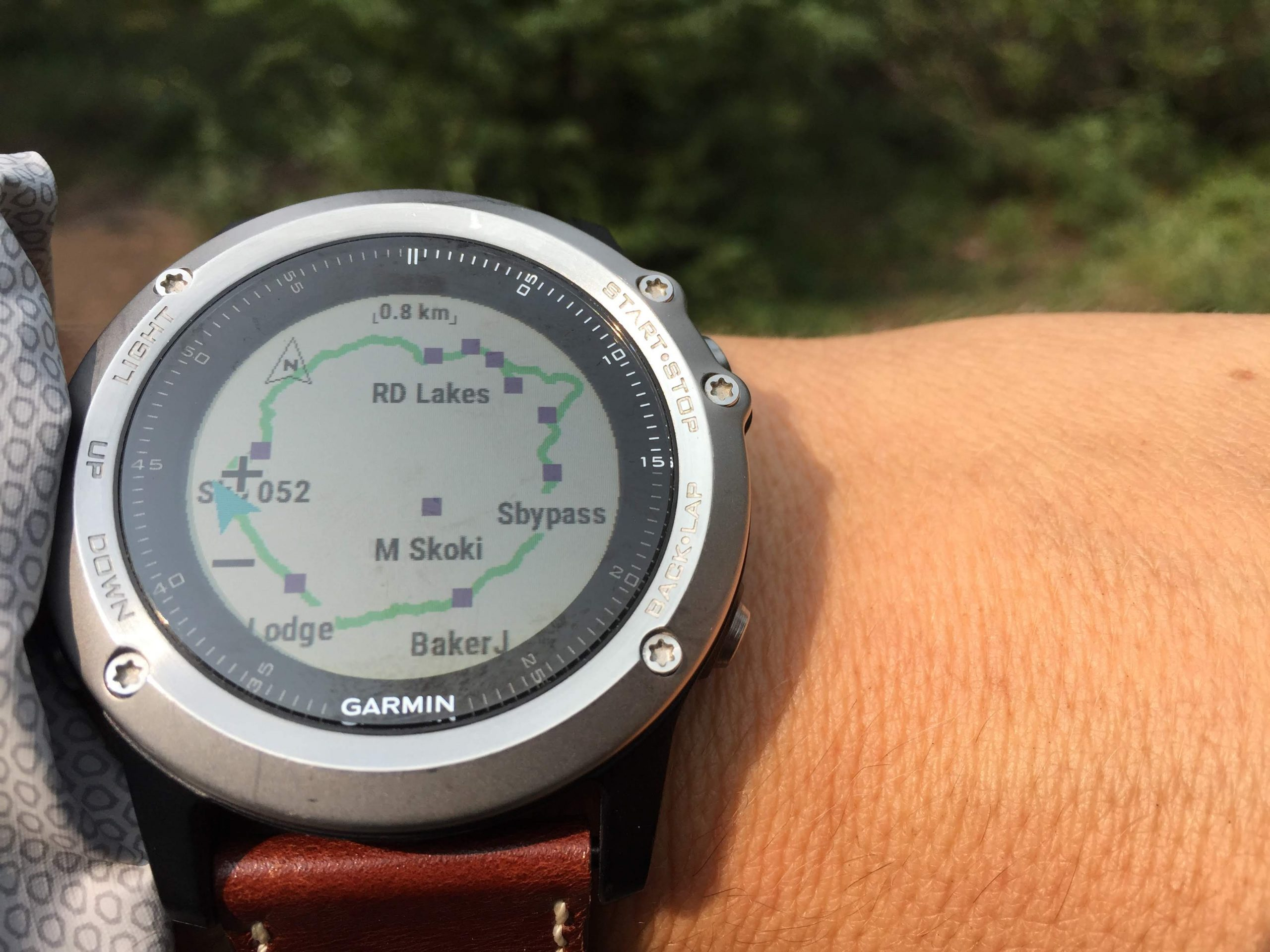 A close-up of a GPS watch showing waypoints on a map.
