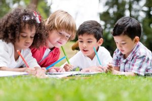 Children drawing on lawn