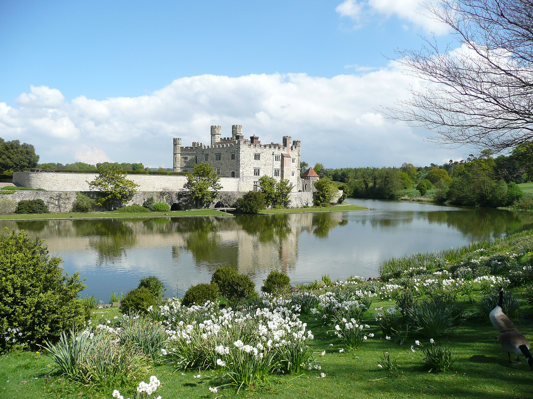 A shot of Leeds Castle during the day from across the lake
