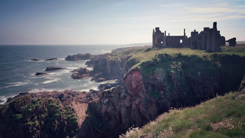 Waves splashing against the cliffs where the ruined New Slains castle stands