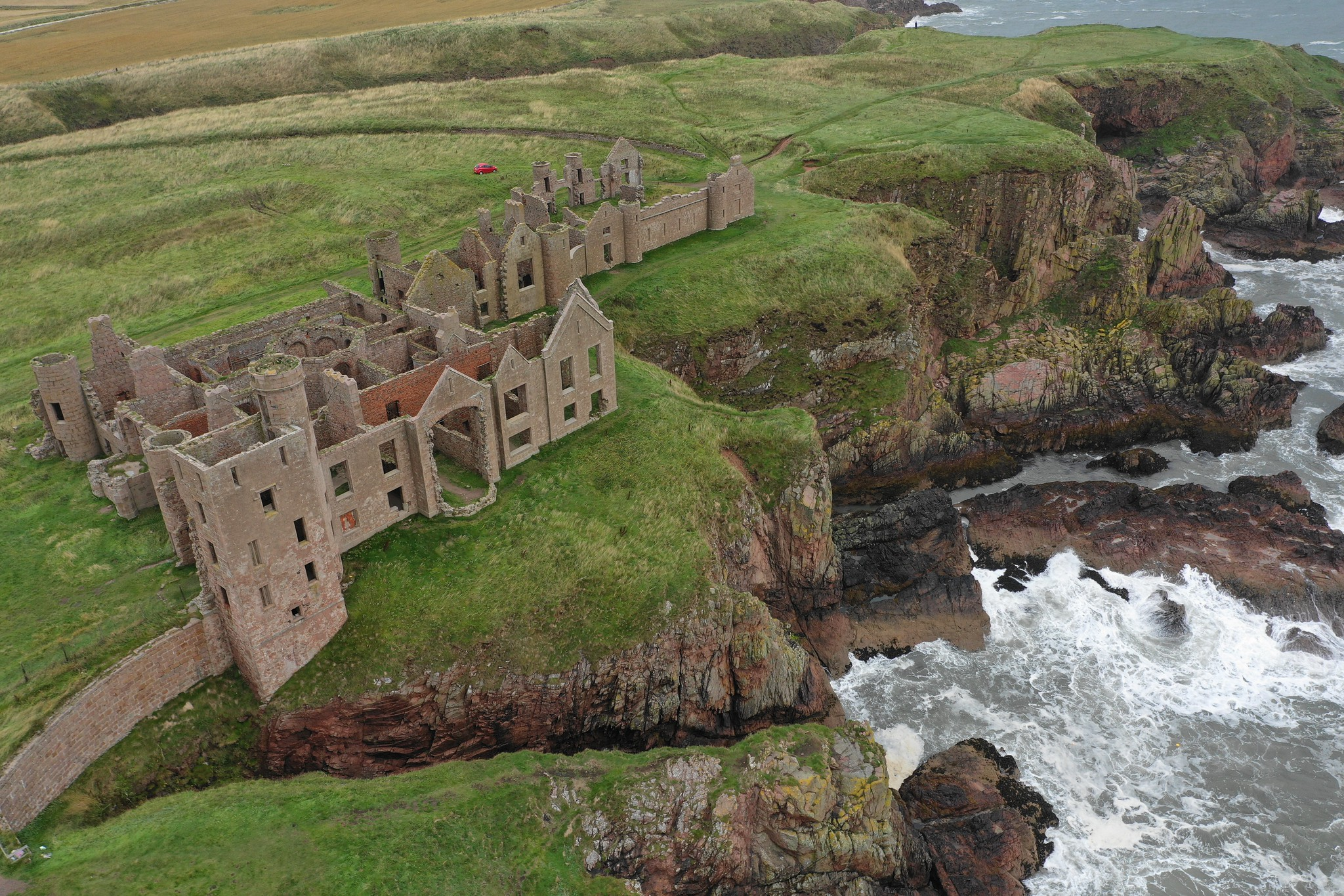 aerial view of slains castle and its rugged cliffs