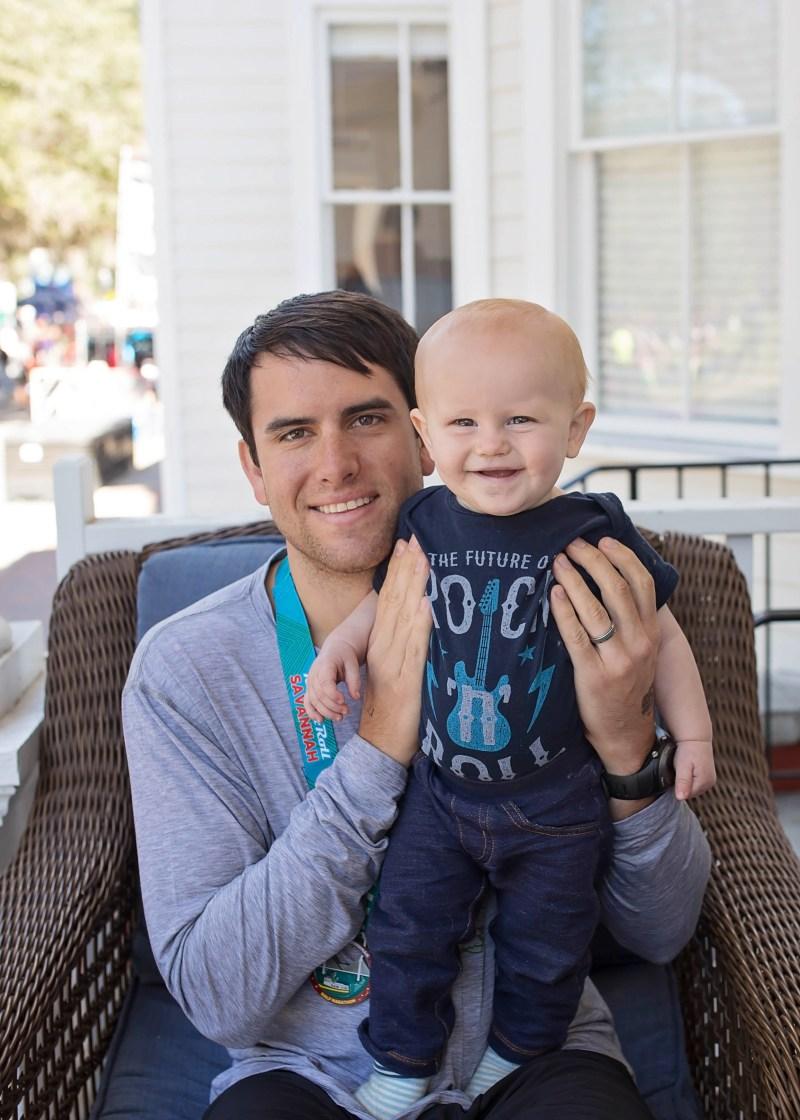 Dad and Baby after running Savannah rock n roll half marathon