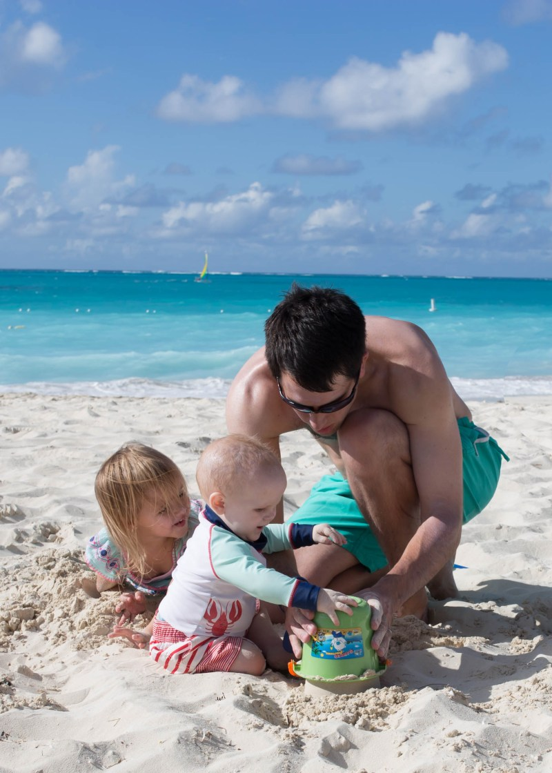 kids and dad at beautiful Turks and Caicos beach