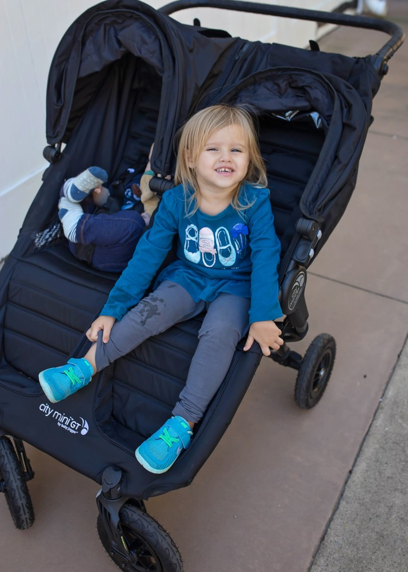 happy toddler in stroller