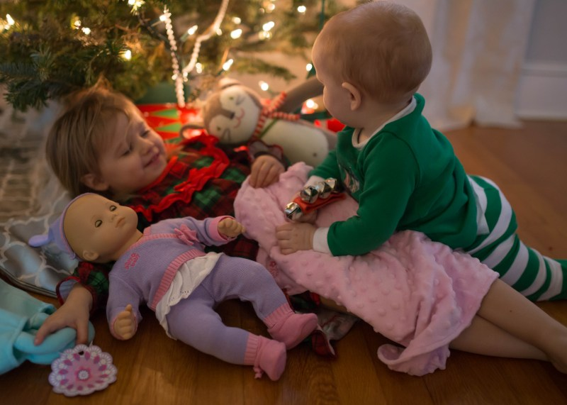 toddler girl and baby boy on christmas siblings