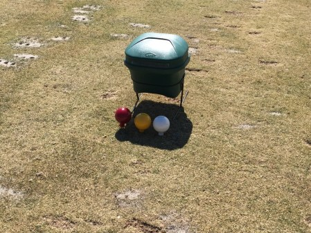 Tee box at Heron Glen. Tee boxes are marked with plastic colored balls.