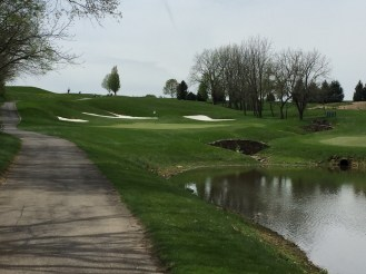 View of 13th green with foot bridges from fairway.