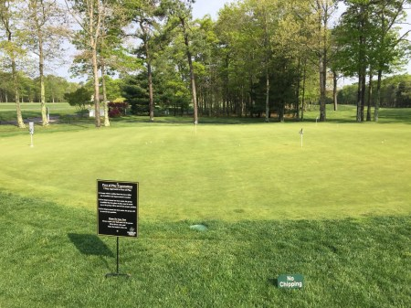Practice putting green next to 1st tee.