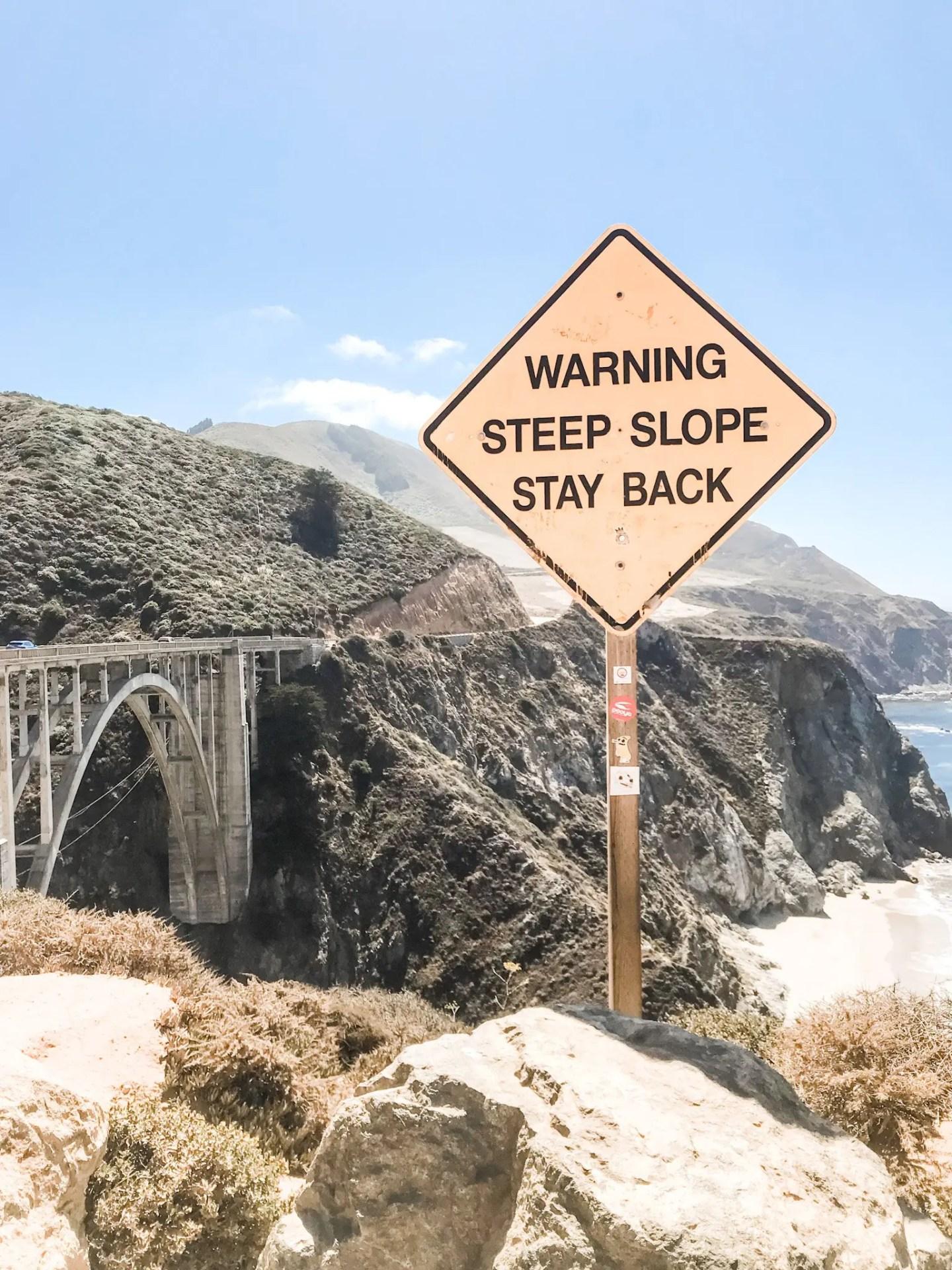 Heed their warning, the cliffs surrounding Bixby Bridge are no joke!