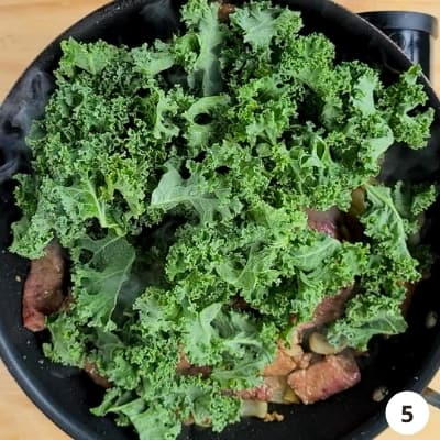 kale leaves added to pan