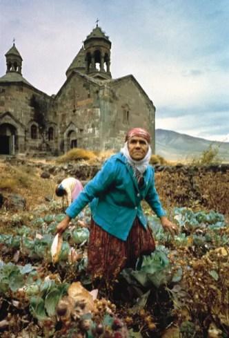 ARMENIA. An old church and vegetable pickers. 1975 Ara Güler / Magnum Photos