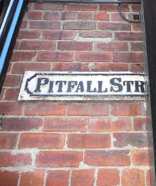 pitfall street sign